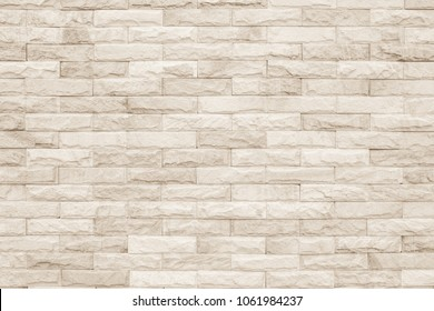 Cream and white brick wall texture background. Brickwork or stonework flooring interior rock old pattern clean concrete grid uneven bricks design stack.