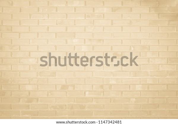 Cream and white brick wall texture background. Brickwork or stonework flooring interior rock old pattern clean concrete grid uneven bricks design stack.