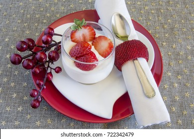 Cream of white chocolate with strawberries, it is a Christmas dessert.