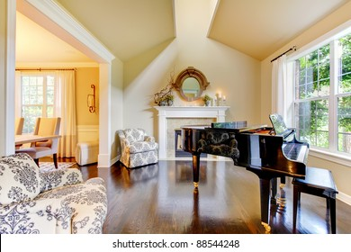 Cream yellow living room with piano and fireplace