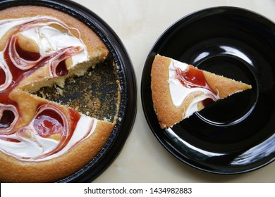 Cream-and-strawberry cake. One cut off piece is on a separate plate. Macro food photo similar to a business or financial diagram, pie chart or infographics. Concept of 'part and whole'.