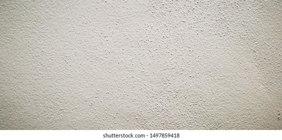 Cream-colored plaster walls with a rough 16: 9 aspect ratio