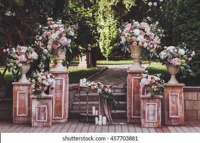 Cream-colored wedding ceremony with fresh flowers
