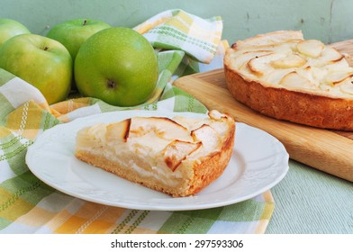 Creamy Apple Pie on a light green wood background