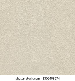 Creamy, beige, light leather background. Vintage fashion background for designers and composing collages. Luxury textured genuine leather of high quality.