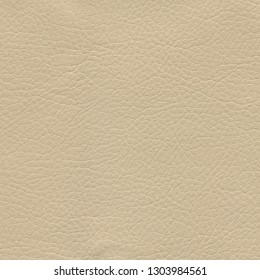 Creamy, brown, light leather background. Vintage fashion background for designers and composing collages. Luxury textured genuine leather of high quality.