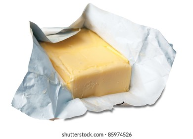 Creamy butter in its unwrapped foil paper. Isolated on white + Clipping Path