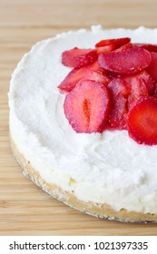 Creamy cake with strawberries and bottom of the cookie