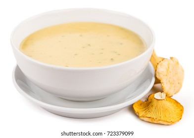 Creamy Chanterelle Soup isolated on white background, selective focus, close-up shot