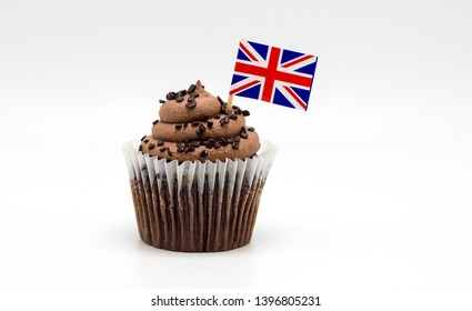 creamy chocolate swirl cupcake with a British Union Jack flag decorated toothpick isolated on white