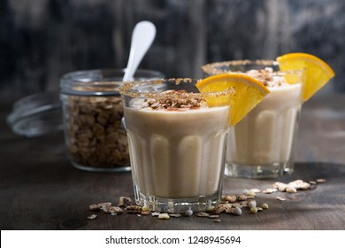 creamy cocktail with oats on dark background, closeup