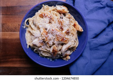 creamy homemade pasta chicken alfredo with parmesan cheese