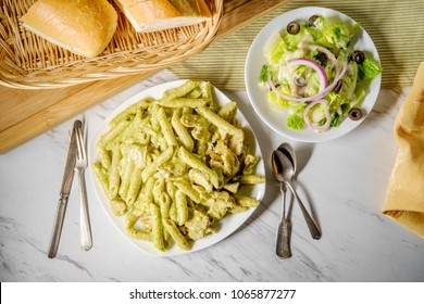 Creamy Italian pesto penne pasta with grilled chicken