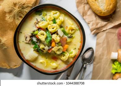 Creamy Italian tortellini wild rice soup with vegetables