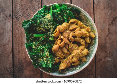 Creamy, low-fat vegan cheese sauce over chic pea soft shells with a side of steamed kale and plenty of nutritional yeast