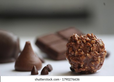 creamy and luscious  Dark chocolate Side view shots Chocolate plating Superfood antioxidant silky smooth choco chips dairy milk mars kisses Ferrero Rocher for chocolate lovers.