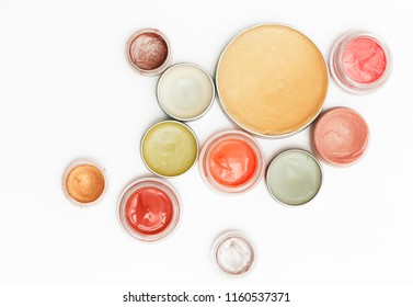 Creamy make up products - top view of decorative cosmetic containers isolated on white backgroiunds