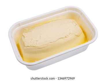 Creamy margarine in an industrial plastic container box. Isolated on white macro studio shot