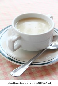 Creamy mushroom soup served on white bowl with silver spoon