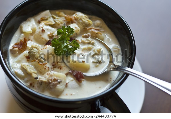 Creamy New England Clam Chowder garnished with parsley
