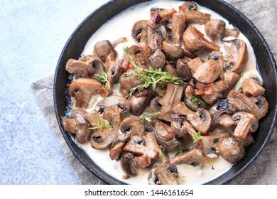 Creamy Parmesan Garlic Mushroom in pan. Creamy mushroom vegetarian recipe.