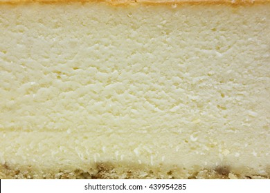 Creamy plain cheesecake texture with crust.