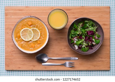Creamy Pumpkin and Lemon Soup with Leaf Salad - Shutterstock ID 1227174652