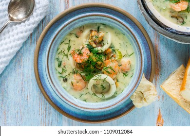 Creamy seafood stew garnished with fresh dill - top view