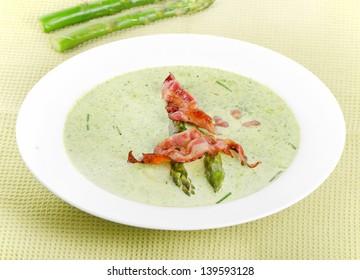 Creamy soup with asparagus and bacon . Selective focus 2d936ed207ab