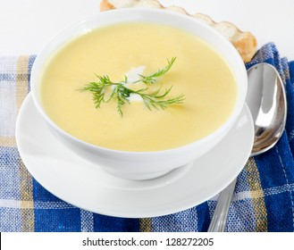 Creamy soup on a wooden table