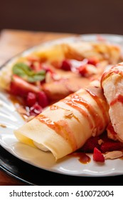 Creamy strawberry crepe with vanilla ice cream and almond, Easy Summer Desserts