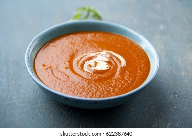 creamy tomato soup with cream on top