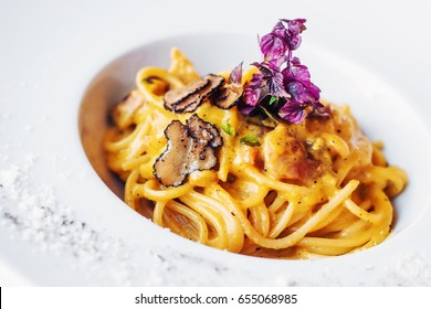 Creamy Tuscan pasta with truffles (selective focus)