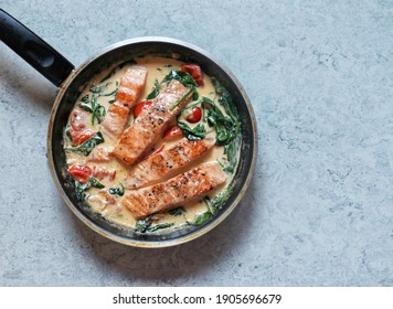 Creamy Tuscan Salmon is a simple but very richly flavoured dish made with salmon cooked and served with a creamy garlic sauce fresh tomato and spinach.