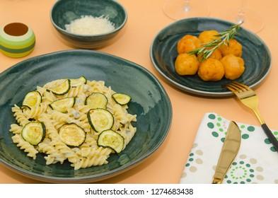Creamy zucchini pasta with gorgonzola sauce. Delicious healthy Italian food. Pasta fusilli with gorgonzola sauce and zucchini
