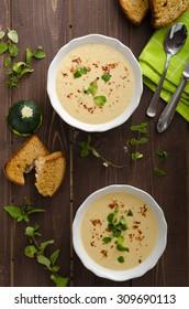 Creamy zucchini soup with chilli and oregano, crispy bread with garlic