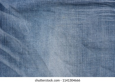 creased blue color  denim fabric background texture