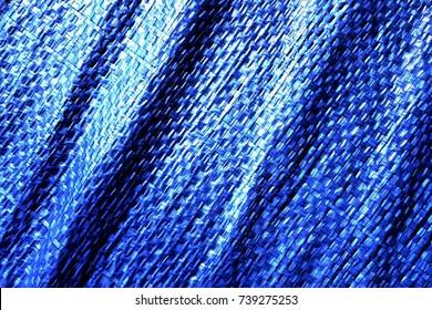 Creased plastic blue polyethylene film texture
