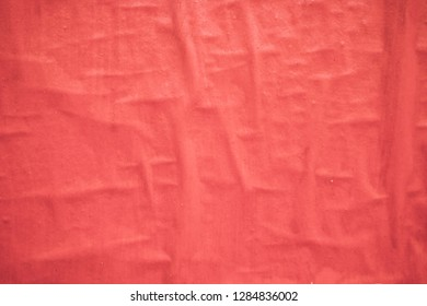 Creased red paper as a background texture