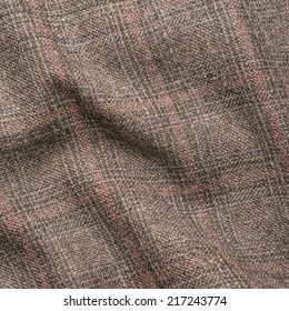 Creased tweed striped jacket cloth material fragment as a background texture composition