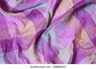 Creasing machine woven textile fabric in yellow - purple and blue plaid