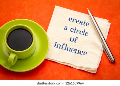 Create a circle of influence advice  - handwriting on a napkin with a cup of coffee