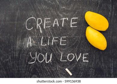 Create life you love motivational advice - text on a slate blackboard with chalk.