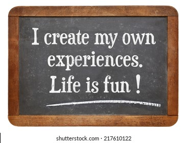 I create my own experiences. Life is fun! Positive affirmation words on a vintage slate blackboard