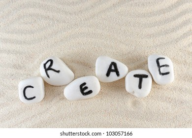 Create word on group of stones with sand as background