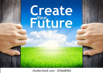 "Create your future. Hand opening an old wooden door and found wording ""Create your future."" over green field and bright blue Sky Sunrise."