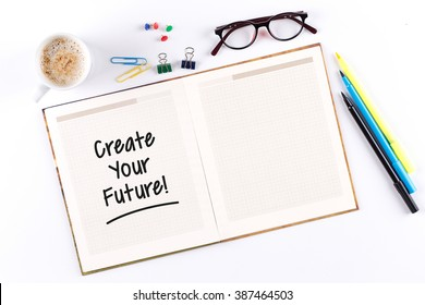 Create Your Future! text on notebook with copy space