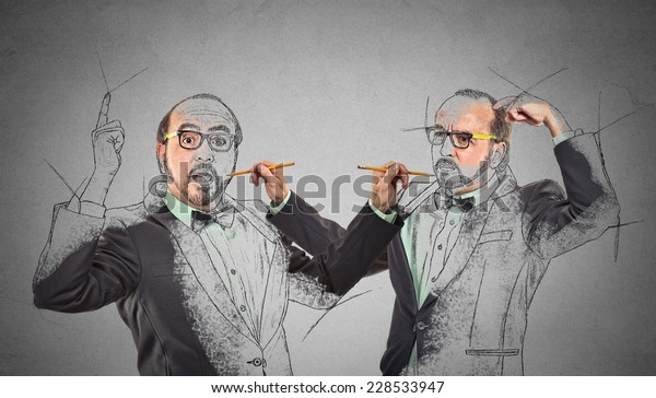 Create yourself, your future destiny, image, career concept. Middle aged man drawing a picture, sketch of himself on grey wall background. Human face expressions, determination, creativity imagination