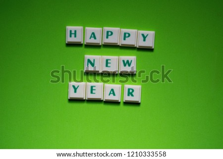created words of happy new year with the letters on the green screen background