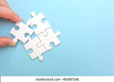 Creating or building own business concept. Puzzle piece, construction and development, build construct, idea and success, solution and growth. Minimal concept.